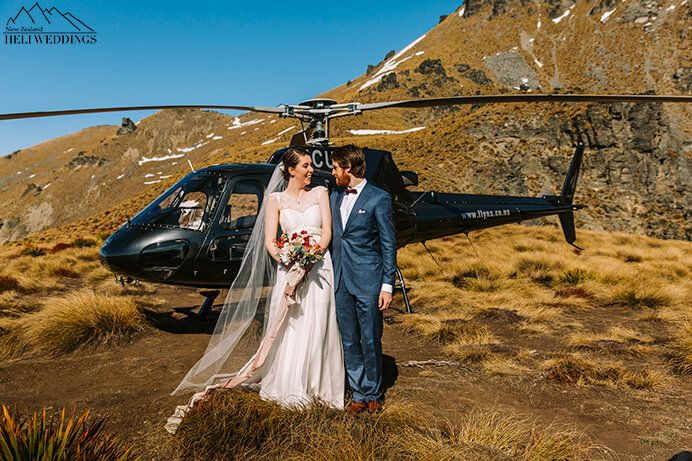 Wedding couple and helicopter