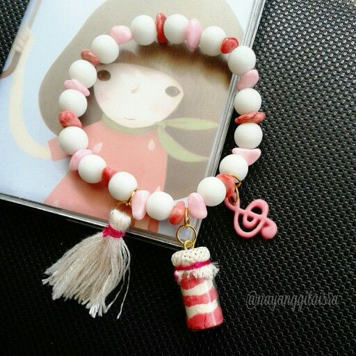 handmade #armcandy with milky white pearl and pink stone beads. and #miniature red velvet #cakeinjar charm in the middle. cute?
