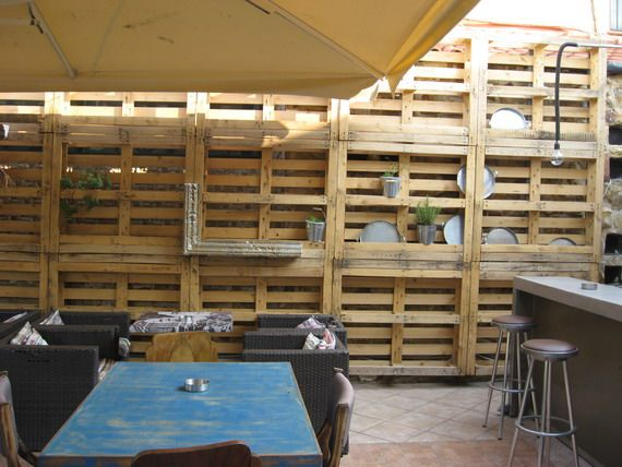 a pallet wall in a cafe in Athens
