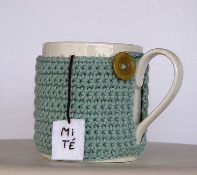 Lady Crochet: my cup of tea  Target is selling mugs with little cable knit cozies right now for the holidays!