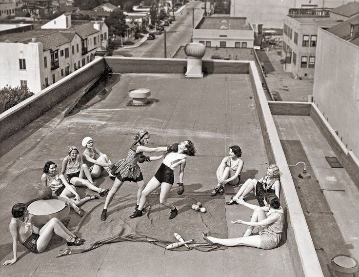Women boxing on a roof, 1938.