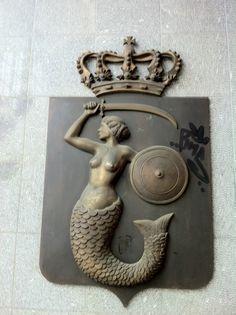 Bronze mermaid plaque of the mermaid of Warsaw at Warschauer Str. Train Station