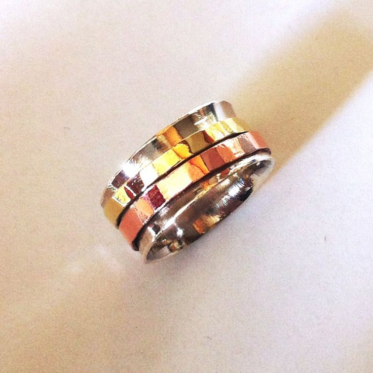 Sterling silver, brass and copper meditation spinning ring £35  #tcff #ccc #gift #shop #forsale #uk #jewellery #buy #ring http://pict.com/p/BNq