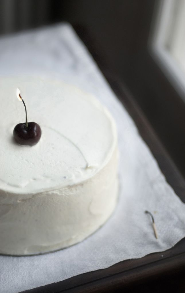 for a sophisticated birthday cake, use a cherry as the candle (i wonder how they did this - soak the stem in liquor?)