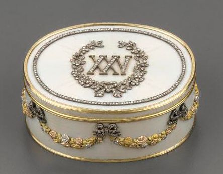 A Fabergé jeweled four-colour gold and enamel anniversary snuff box, workmaster H. Wigström, St Petersburg, 1908-1917, oval, enameled overall in translucent opalescent white over sunburst and banded engine-turning, the lid applied with diamond-set roman numerals XXV bordered by ribbon-tied floral sprays, jeweled outer band, the sides with richly chased four-colour gold garlands suspended by diamond-set bows.