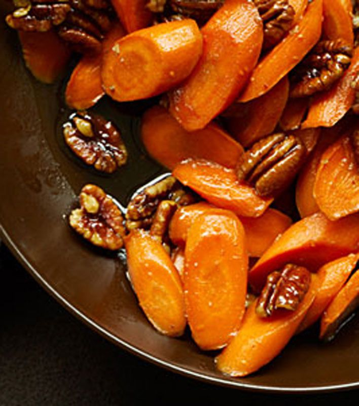 Recipe For Glazed Carrots with Pecans - This five-ingredient carrot side dish recipe comes together quickly and adds warm flavor to any menu.