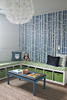lay 2 bookshelves on their side & top off with cushions to make this modern bench with storage.