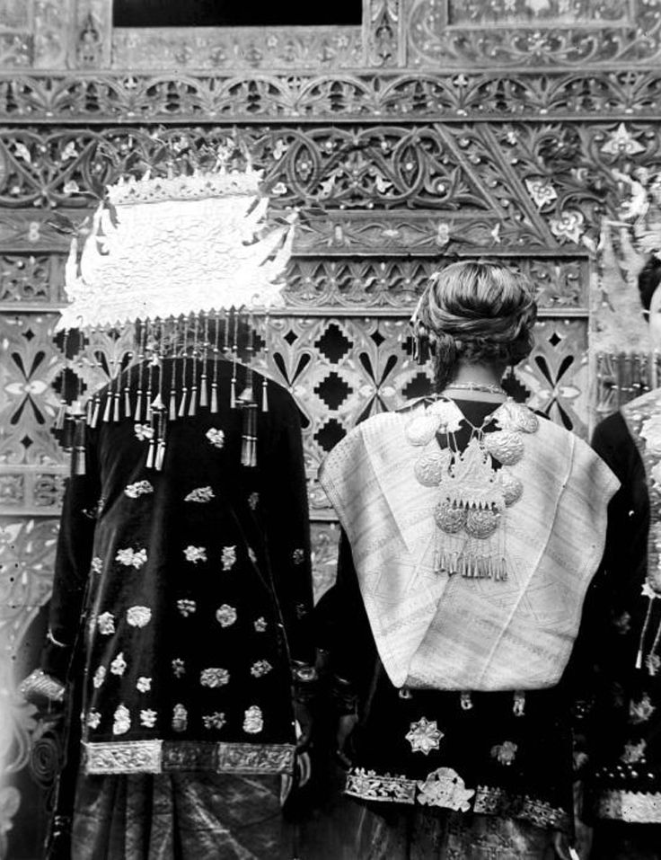 Indonesia ~ West Sumatra, Solok | Two Minangkabau women wearing jewellery, photographed from the back | Date and photographer unknown