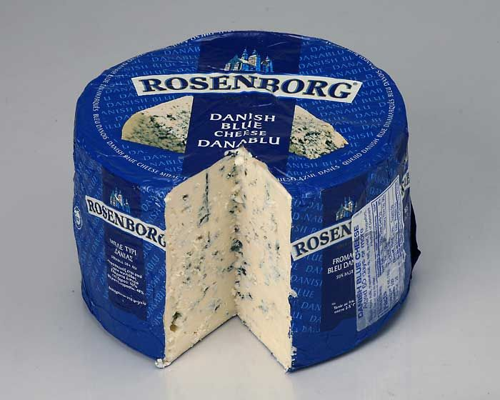 Danish Blue Cheese (Danablu) ~ is a strong, blue-veined cheese. This semi-soft cheese is typically wheel or block shaped and has a white to yellowish, slightly moist, edible rind. Made from cow's milk and aged for 8-12 weeks. Danish Blue has a milder flavor than French Roquefort style cheese yet is characterized by a sharp, salty taste. Danish Blue is often served crumbled on salads or as a dessert cheese with fruit. #Denmark #Danish_Cheese