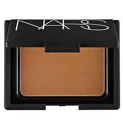 Shop NARS' Bronzing Powder at Sephora. This bronzer has a rich brown shade with a gold shimmer finish.