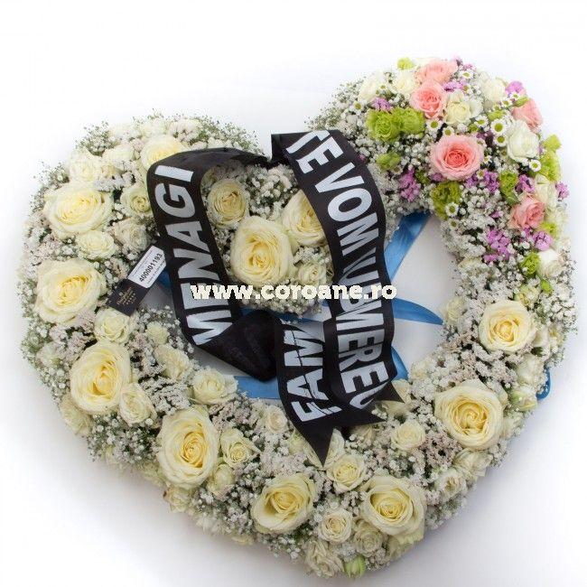 Coroana inima eleganta cu flori delicate si de primavara! nima are o dimensiune de 65 cm aproximativ si este creata cu suport pe baza de burete flloral imbibat cu apa, fapt ce asigura o viata indelungata pentru flori. Coroana este creata din trandafiri albi, trandafiri roz, gypsophila, santini.