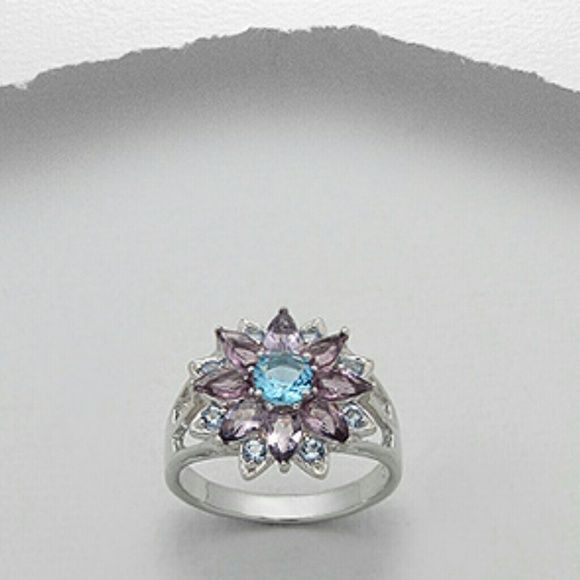 IN STOCK Amethyst & Blue Topaz 925 Silver Ring LIKE THIS LISITING TO BE NOTIFIED IF THE PRICE DROPS! Beautiful NWT Purple Amethyst and Blue Topaz Sterling Silver Ring. Size 6.5. *FEBRUARY AND DECEMBER BIRTH STONES!* Hallmarked 925 sterling silver. Brand new, never worn. Comes in original packaging. Feel free to ask any questions. PRICED TO SELL! Bundle for further discounts. Boutique  Jewelry Rings