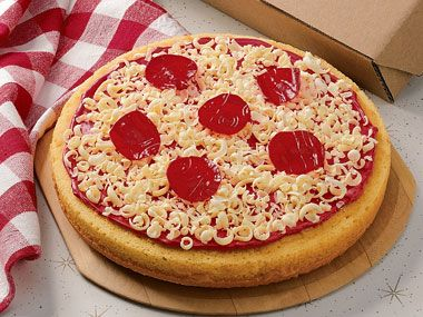 Think this is a pizza?  Think again.  It's a Pizza Cake!  With white chocolate gratings for cheese and Fruit Roll-Up pepperoni slices, this funny cake really does look like a piping hot pizza.
