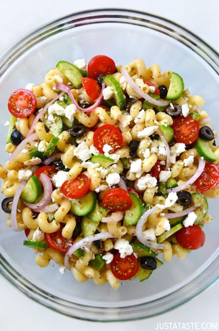 Hit up the farmers' market for seasonal veggies that'll amp up plain old penne or rotini. A homemade vinaigrette with hints of oregano and garlic adds the finishing touch to this Greek pasta salad. Click through for easy cold pasta salad ideas that are perfect for summer.