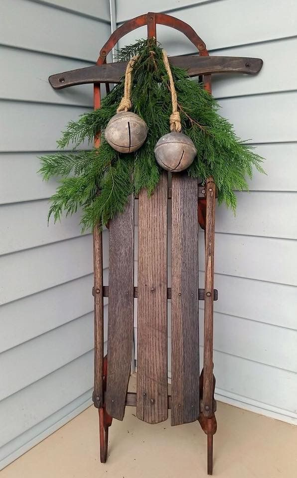Sled decorated with jingle bells for Christmas!