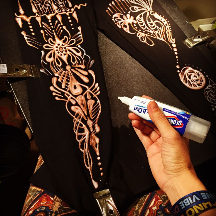 Drawing on black leggings with a Clorox Bleach pen.