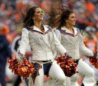 Denver Broncos cheerleaders perform - Jack Dempsey/AP