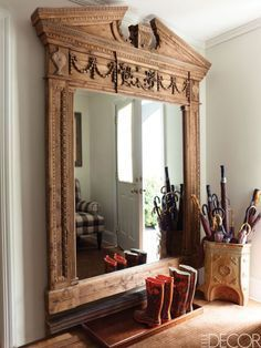 A Restoration Hardware mirror was customized to fit the mudroom of television personality Sandra Lee's Colonial-Style house is Westchester County, New York; an antique stoneware cistern was repurposed as an umbrella stand, and the wallpaper is by Stroheim. Get the look: Entablature Mirror, $496; restorationhardware.com