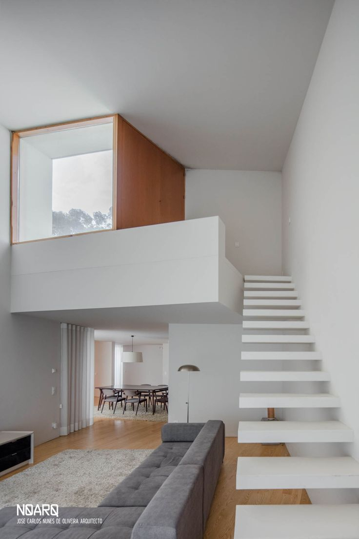 M&M HOUSE – Living room - #noarq #house #interior #living #doublehighspace #stairs #window #whitedesign #wooddesign by José Carlos Nunes de Oliveira - © NOARQ - Photography by João Morgado