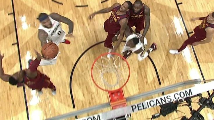 DeMarcus Cousins drives in and finishes with a layup while drawing a foul on Dwyane Wade late in the third quarter.