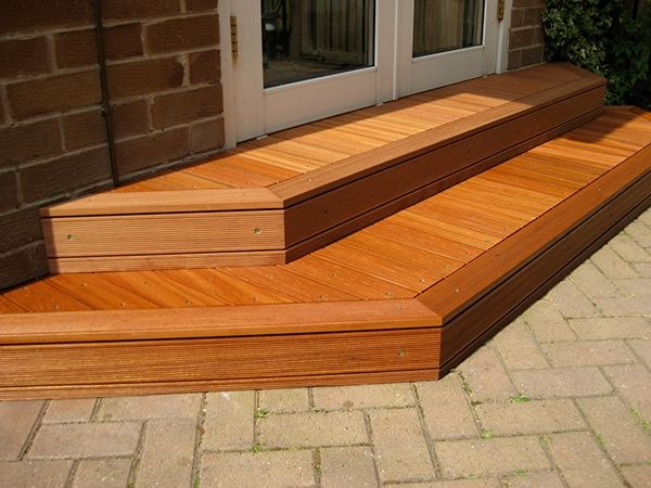 Hardwood decking steps outside a set of french doors. Yellow Balau decking used and finished with oil.