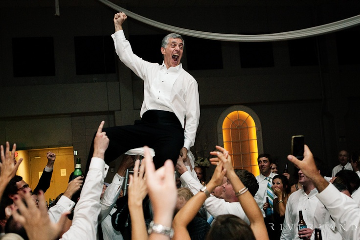Dad dancing at reception, Greek tradition
