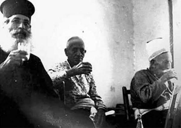 Greek priest and Turkish imam are enjoying some coffee together in Cyprus 1953 [600x426]