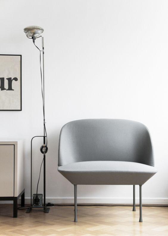 The Oslo Minimalist armchair by Muuto . Danish furniture design. Minimal Scandinavian living room with herringbone flooring.