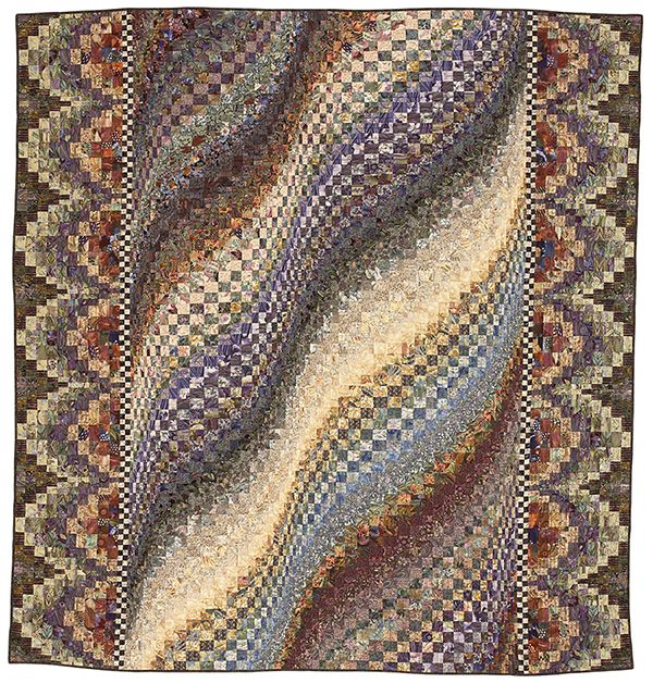 """Rolling Prairie: Envision meadow grasses rippling in the wind when arranging the strips of this head-turning and skill-building bargello quilt. Finished quilt: 90-3/8x95"""" (double size with 18"""" drop; queen size with 14"""" drop). Designer: Mabeth Oxenreider."""