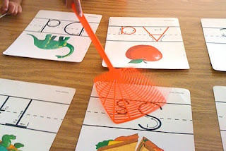 Swat the Sound - I say a letter, word, or sound, and they have to swat the correct alphabet card with the fly swatter