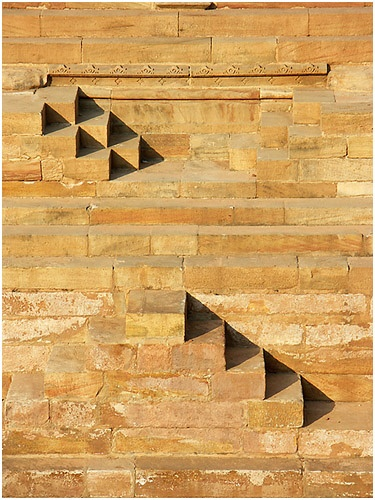 triangular shadows in the huge stepwell structure, in the front of sun temple of modhera.