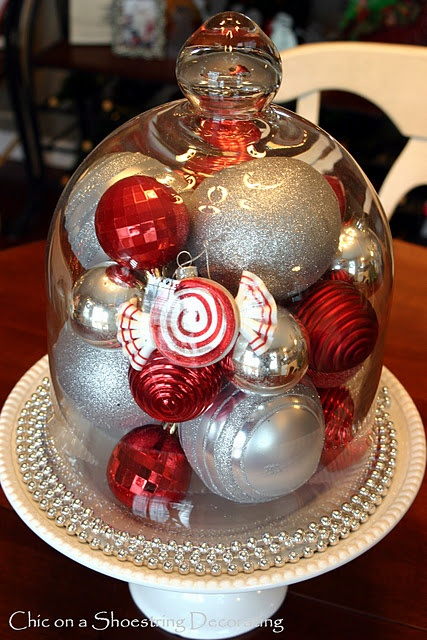 Christmas centerpiece ornaments in a cloche