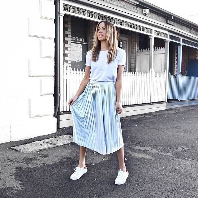 Our hero piece? The pleated midi skirt. We're pairing ours with a plain white…