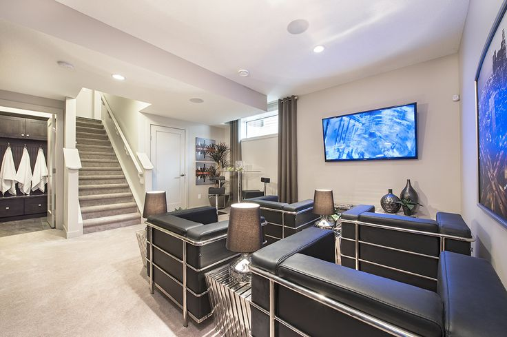 Entertain with a modern sense of style in the developed basement of Jayman MasterBUILTs Allure<br></a>showhome in Secord, Edmonton. Artfully placed cityscapes pop against a neutral wall colour<br/>and perfectly accent the chrome and leather textures that bring this space to life.