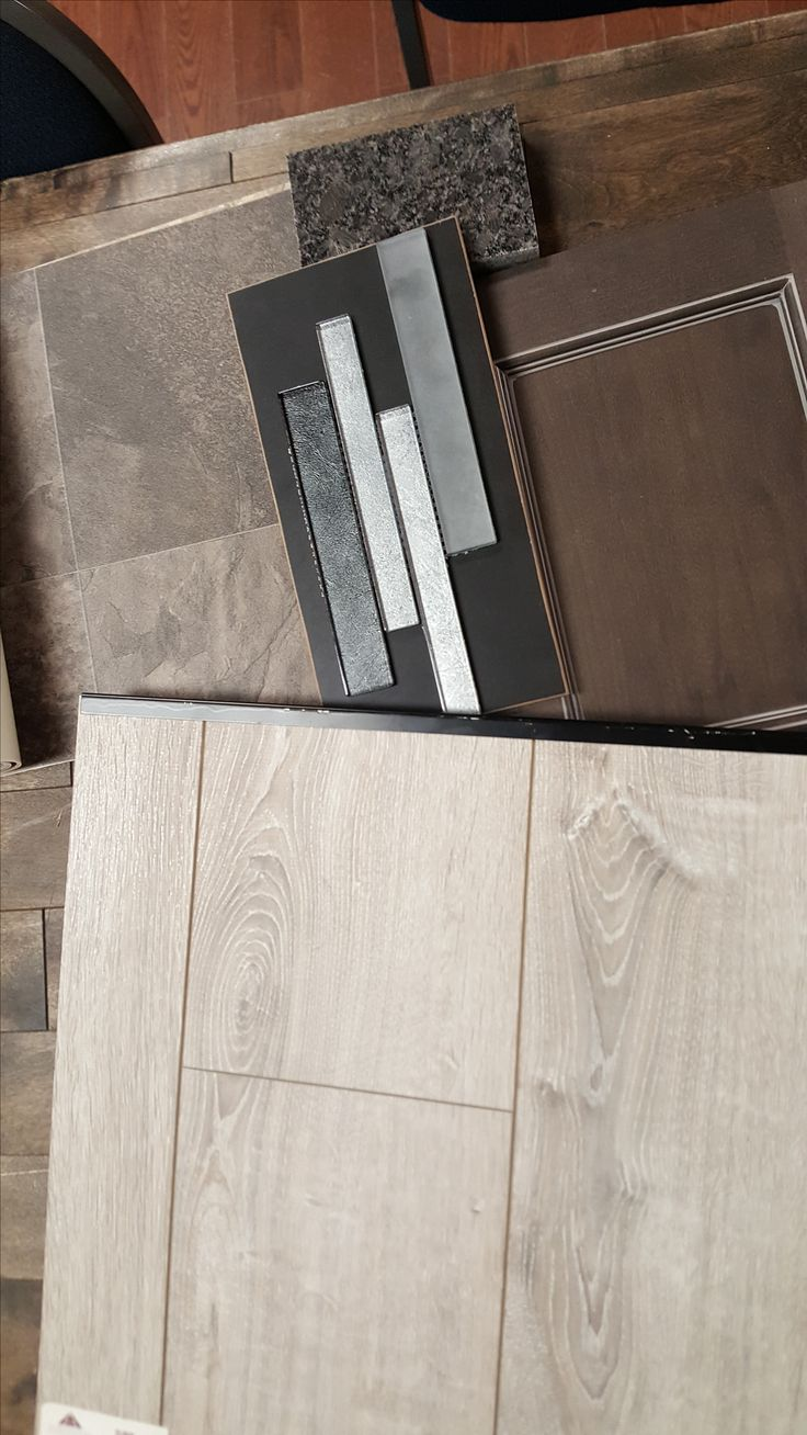 #Solid Plus Laminate - Sardinia Oak  #Armstrong Sheet Vinyl - Matchbox Strike #Universal Slate - Turkish Glass Mosaic #Granite - Silver Pearl   #Cabinets - Thunder Pewter Glaze