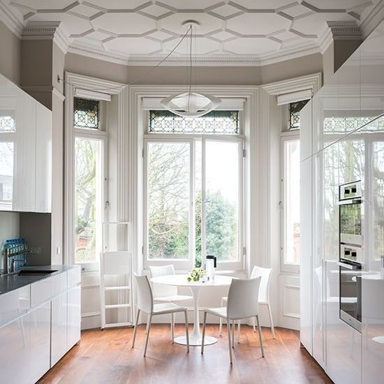 Talk about show-stopping! This modern gloss kitchen contrasts beautifully with the traditional architectural elements of this amazing space