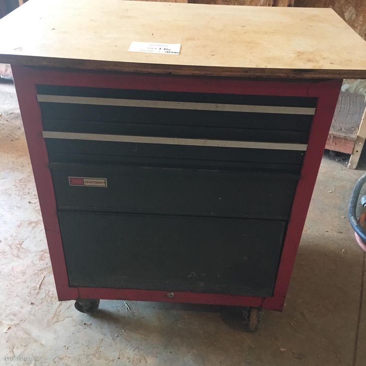 Online bidding available! Rolling Craftsman Tool Box with 3 drawers and one cabinet on the bottom. Top drawer does not open and no key available. Mounted formica work table on top. Older carry craftsman tool box. A bit...