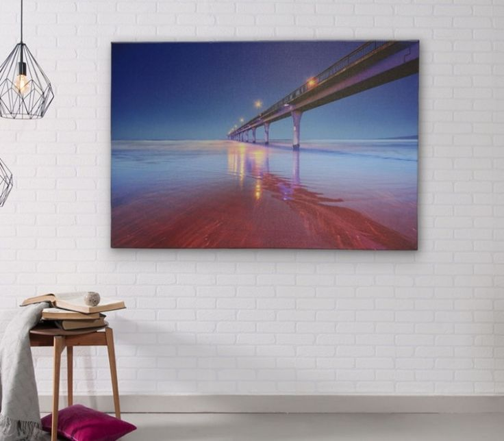 Decorate your living room wall with an impressive and a stunning canvas art print? Visit #PrintsOnGlass to know more.