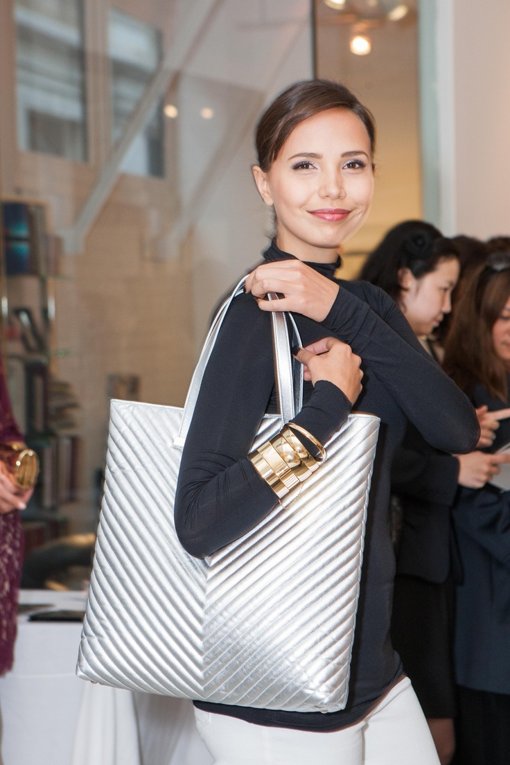 Barbara of Scout Models carries Jill Milan's silver tote.