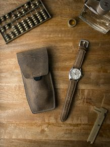 """Bas and Lokes brown oil tan """"Kingsford"""" handcrafted leather watch pouch next to a handsome Rolex Datejust with our """"Massimo"""" tan suede watch strap. Pouch and strap both available at www.basandlokes.com"""