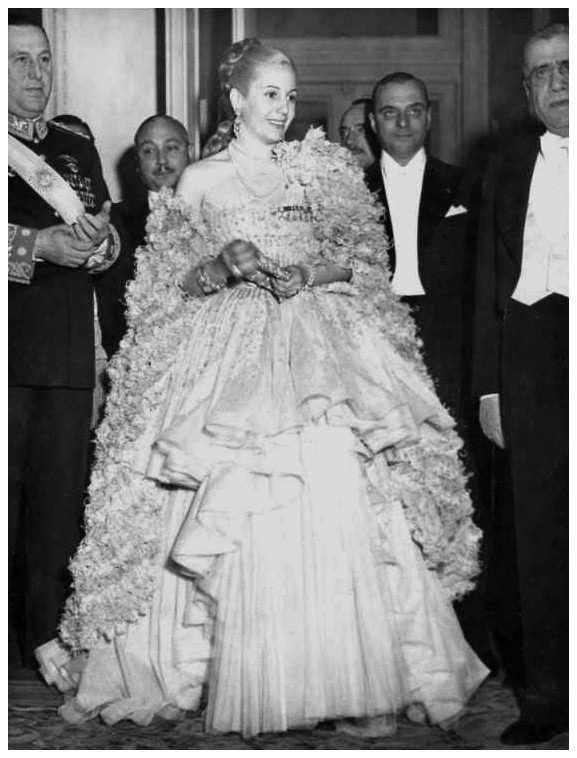 A splendid Eva Perón with President Juan Domingo Perón and senior officials.