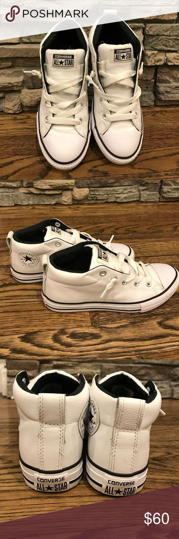 White leather converse size 4 kids 7 adults White leather half tops. Lace up. Perfect condition like brand new. These are kids 4 but I'm a size 7 and I fit into them. I no longer have a box Converse Shoes Sneakers