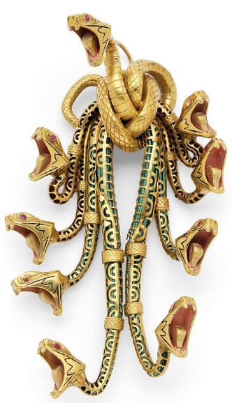 Antique Enamel and Gold Serpent Pendant  Of mythological motif, the Hydra designed as a nine-headed snake with openwork tubular bodies containing either green cord or brown braided hair, each head with simulated ruby eyes, fanged mouths embellished by pink enamel details, in 18kt gold, late 19th century