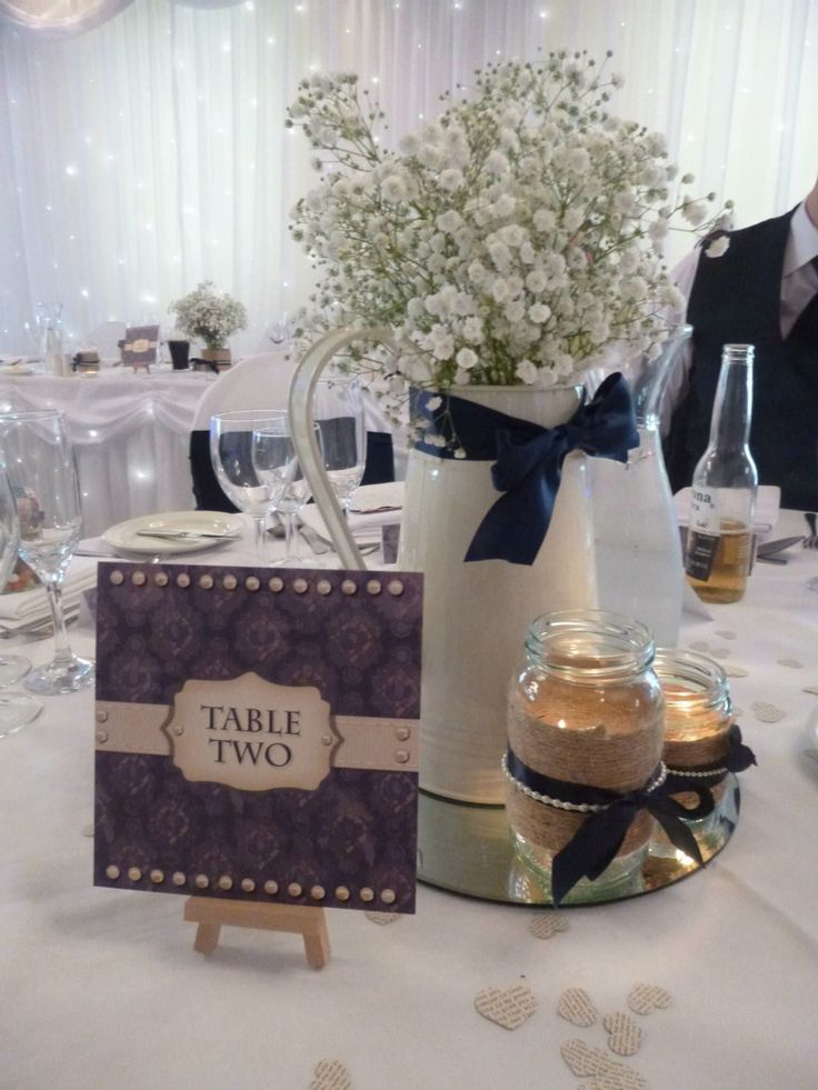 My wedding centre pieces , water jug filled with fresh gypsophila , homemade tealights and newspaper cutting confetti .