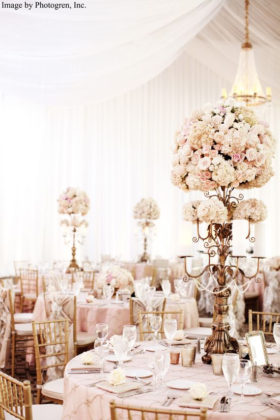 Pink and Gold reception decor; soft pink large blooms and table linens with gold candelabra decor and gold Chiavari chairs