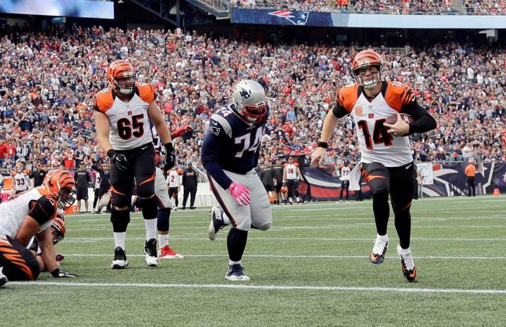 Bengals vs. Patriots:     October 16, 2016  -  35-17, Patriots  -    Cincinnati Bengals quarterback Andy Dalton (14) runs past New England Patriots defensive lineman Woodrow Hamilton (74) for a touchdown during the first half of an NFL football game, Sunday, Oct. 16, 2016, in Foxborough, Mass.