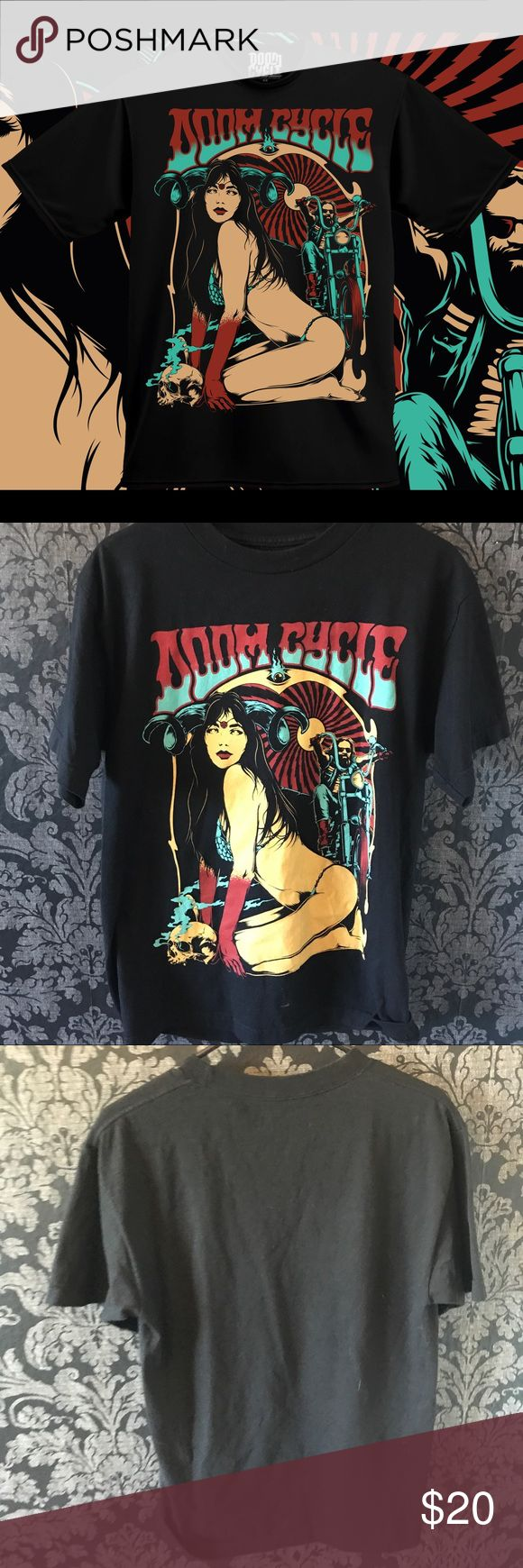 Doom Cycle Nyx Berndt Tee Black men's tee shirt with a crew neck and short sleeve, trip color print in yellow, red, and bright blue or cyan. Doom cycle motorcycle trippy shirt with psychedelic groovy font wording that imitates stoner metal tees. Print shows a Bikini near nude woman Saturday with ram antlers covered in blood with a man on a motorcycle behind her and a skull and smoke. Never before worn. Size medium. Occult, Harley Davidson, chopper, biker, metal, pagan, devil, Satan, satanic…