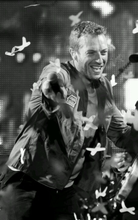 Chris Martin of coldplay among the butterflies