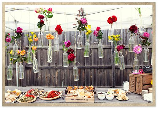 cute...use glass soda or wine bottles as vases & hang.  use planter boxes or crates as shelves.  have pic nic type theme
