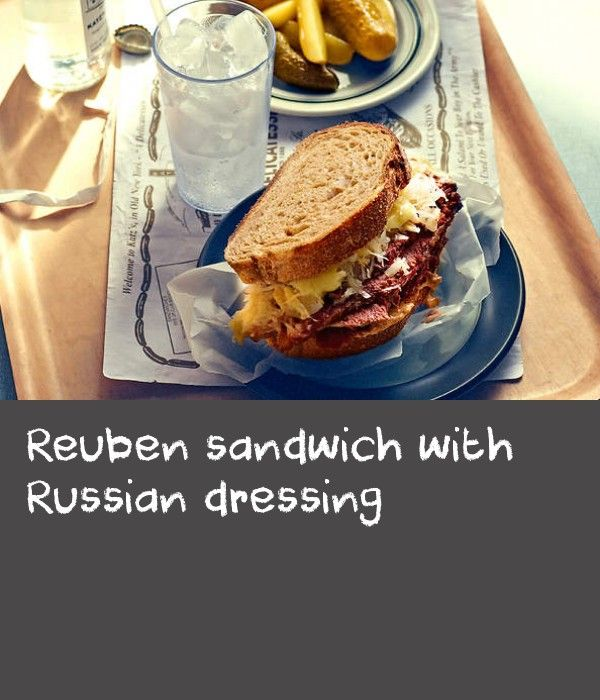 Reuben sandwich with Russian dressing | The exact history of the Reuben remains undocumented, but this roast beef sandwich filled with sauerkraut, cheese, pickles and Russian dressing is a classic Jewish deli lunch item and has been around since 1920s in New York.